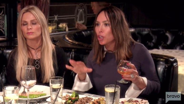 Kelly Dodd talking with Tamra Judge sitting next to her