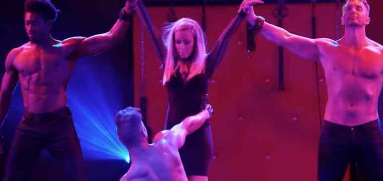 Kendra with make strippers holding her arms up