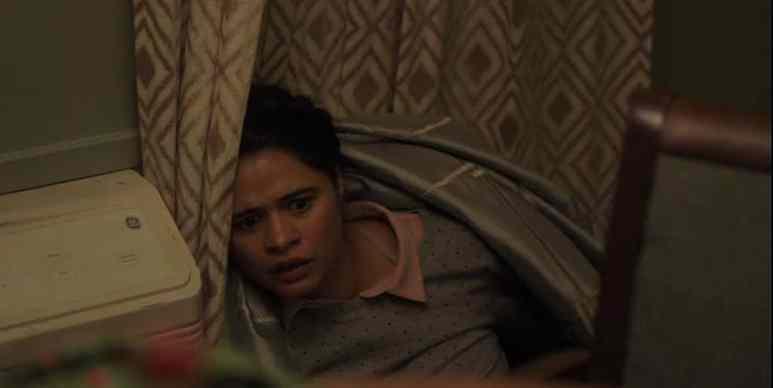 Meg (Melonie Diaz), cowering on the floor