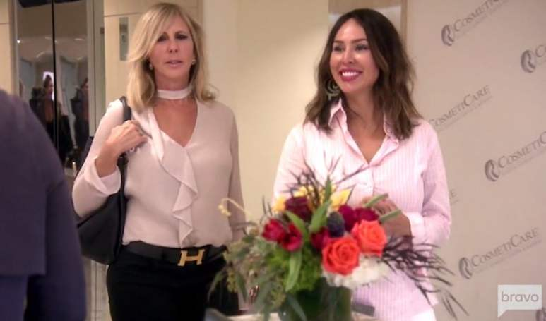 Kelly grinning as she arrives at the plastic surgery clinic with Vicki