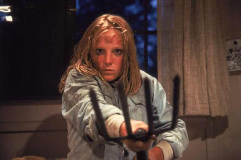 Amy Steel holding a pitchfork in Friday the 13th Part 2