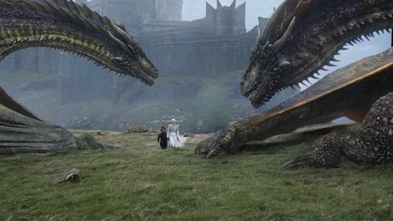 Daenerys and Tyrion walking on grass by her dragons on Game of Thrones: Beyond the Wall