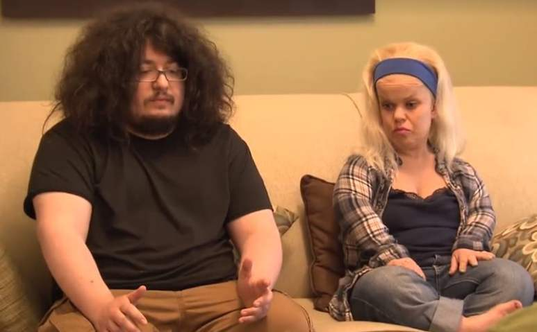 Brian and Lila Call sitting on a couch on Little Women LA: Couples Retreat
