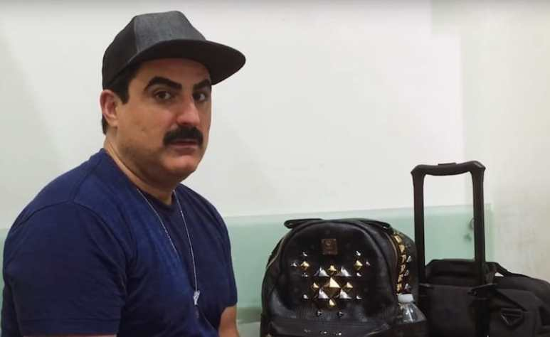 Reza Farahan speaking to the camera while being detained on Shahs of Sunset