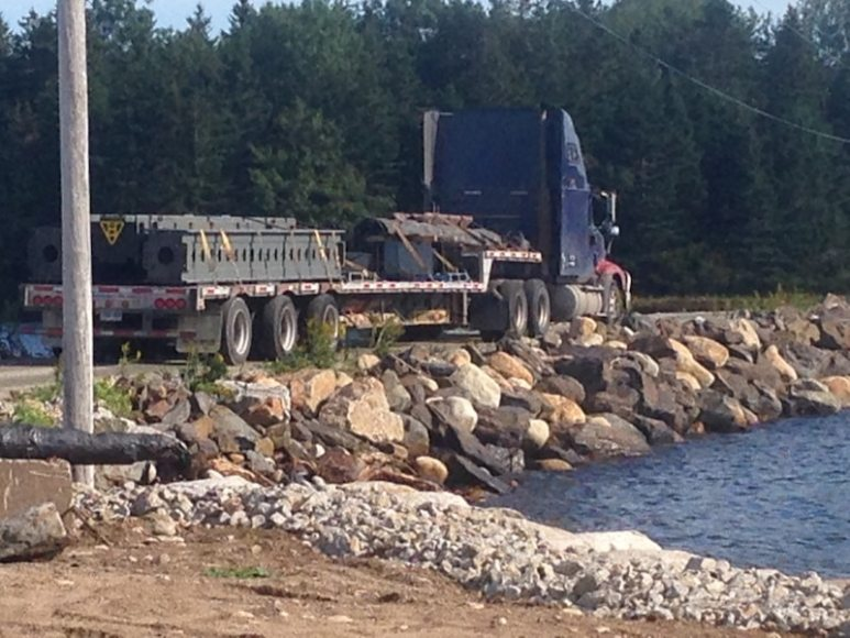 A truck crosses the Oak Island causeway