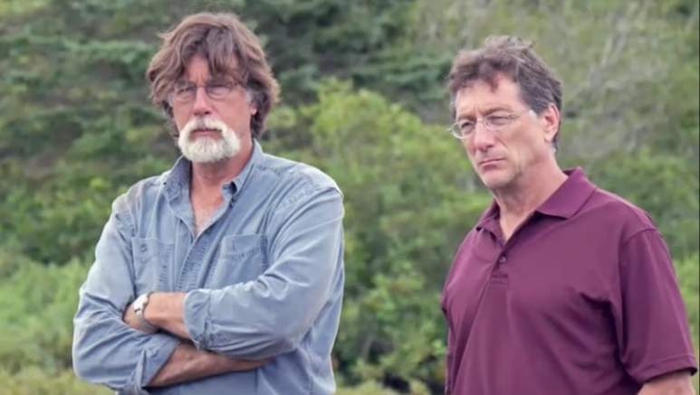 Rick and Marty Lagina standing by a dig on The Curse of Oak Island