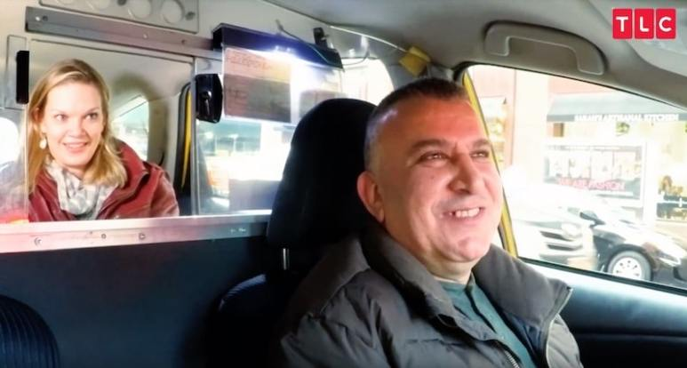 Katja joking with a cab driver on My Giant Life