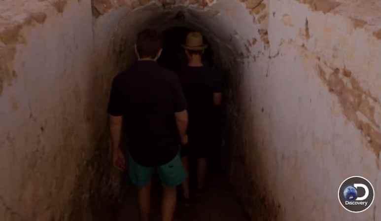 Doug Laux and Ben Smith entering underground tunnel