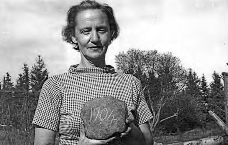 Mildred Restall with the 1704 stone found on Oak Island