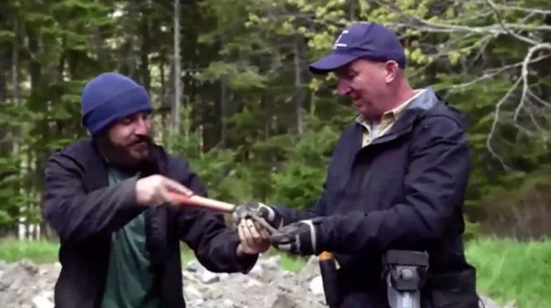 Jack Begley and Gary Drayton finding the rose-headed nail
