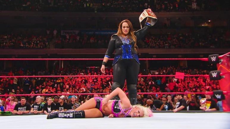 Nia Jax stands over Alexa Bliss