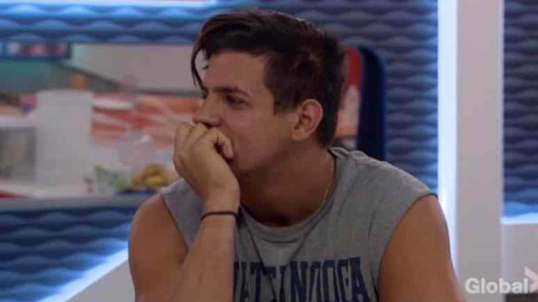 Faysal looking confused in the Big Brother kitchen