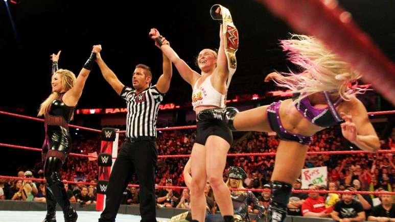 Alexa hits Ronda in the ribs