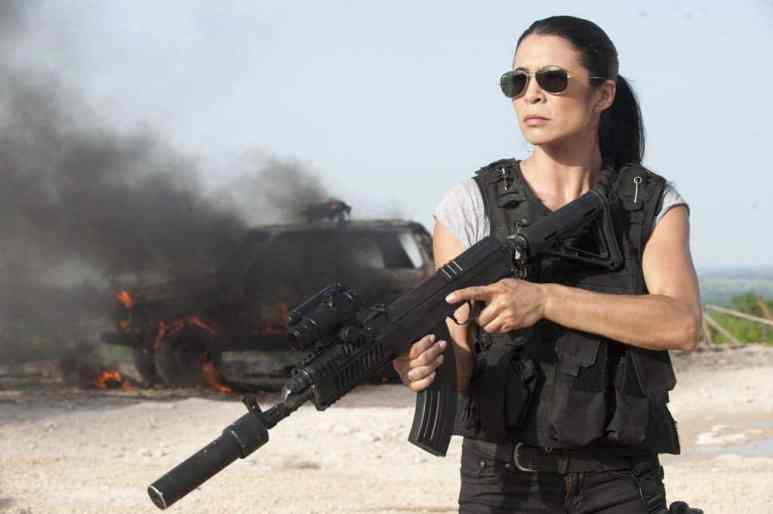 Rhona Mitra holding a gun in Strikeback
