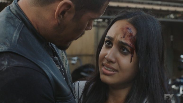 Still Image from Mayans M.C. Cucaracha/K'uruch. Leti blames her self-inflicted wounds on Celia, causing Coco to react under false accusations. Pic Credit: FX.