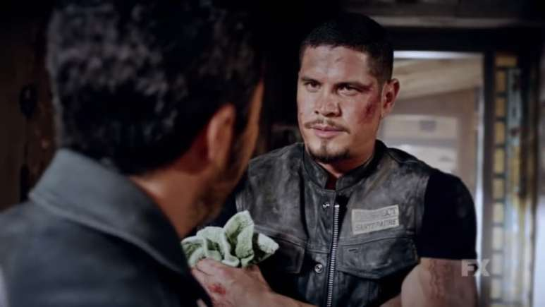 Still image from Mayans M.C. Cucaracha/K'uruch preview. President Bishop remarks on EZ's intellence as EZ appears injured. Pic Credit: FX