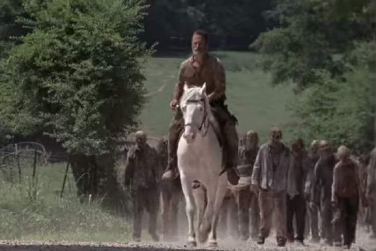 Rick Grimes (played by Andrew Lincoln) leads walkers on The Walking Dead