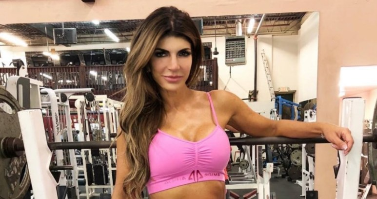 Teresa Giudice in the gym training for a weight lifting competition.