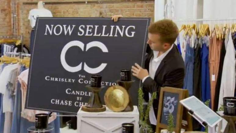 Chase Chrisley with the Candles by Chrisley display