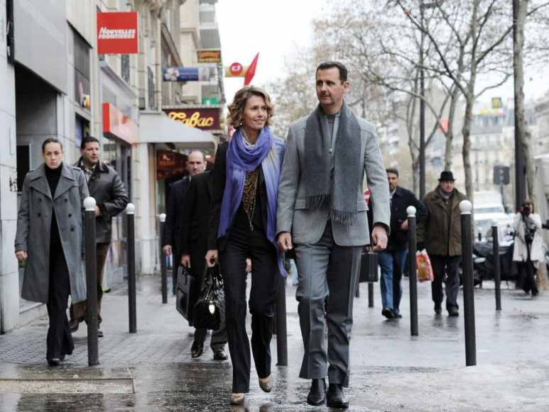 Syrian president Bashar al-Assad and his wife Asma in Paris. Pic credit: Nat Geo via MIGUEL MEDINA/AFP/Getty Images