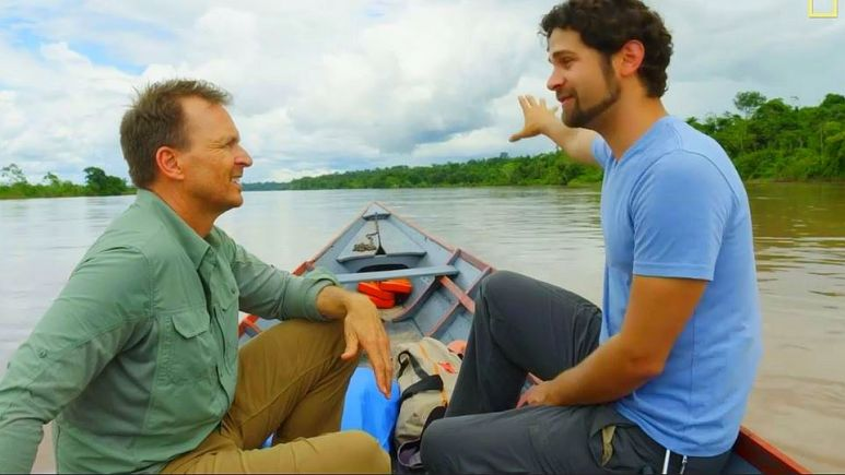 Andrés Ruzo tells Phil Keoghan about the boiling river, which begins normal temperature until the area where it heats up. Pic credit: Nat Geo Channel