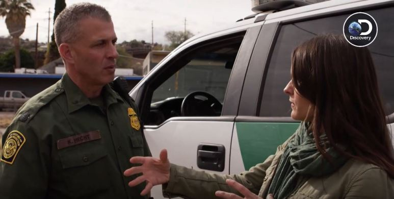 Deputy patrol agent in charge Kevin Hecht explains to Lilia the logistics of how easy it is to tunnel in that area. Pic credit: Discovery