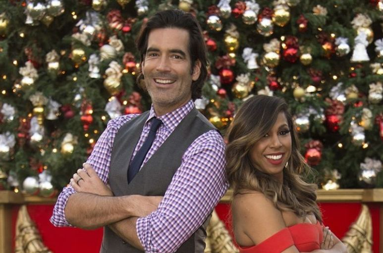 Carter Oosterhouse and Taniya Nayak, hosts of The Great Christmas Light Fight