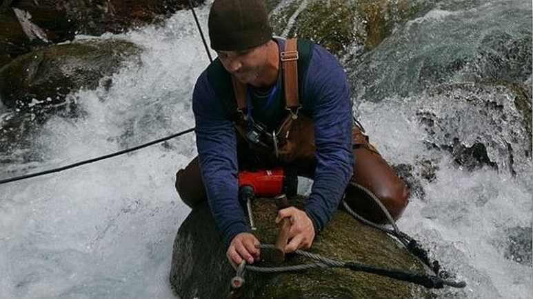 Dustin Hurt is rigging up something to allow them to get down to the bedrock. Pic credit: Discovery