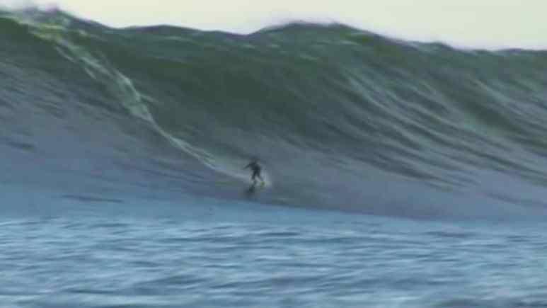 Chris Brown surfing a massive tube at Mavericks