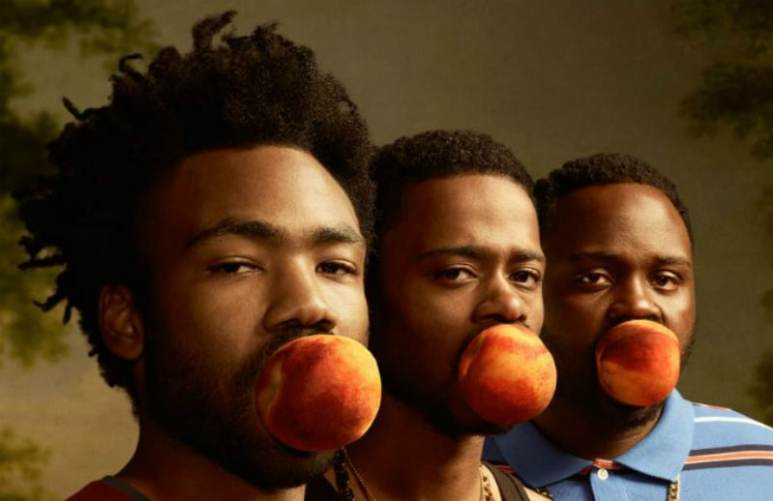 Donald Glover, Brian Tyree Henry and LaKeith Stanfield post for the Atlanta promo poster with peaches in their mouths.