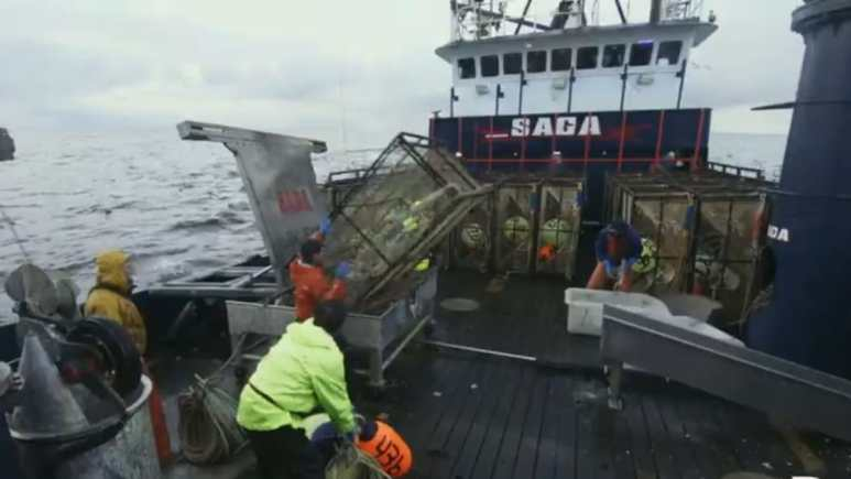 The moment the metal pot springs from its unsecured locking device and falls towards the men on deck. ic credit: Discovery