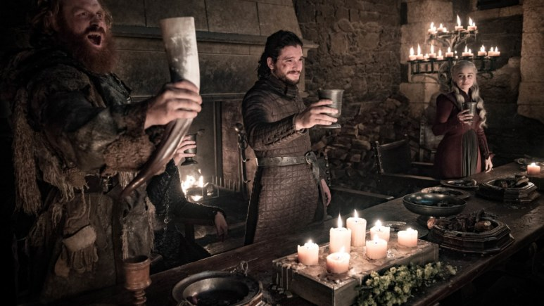 Jon Snow raises his cup, which is clearly not the Starbucks cup.