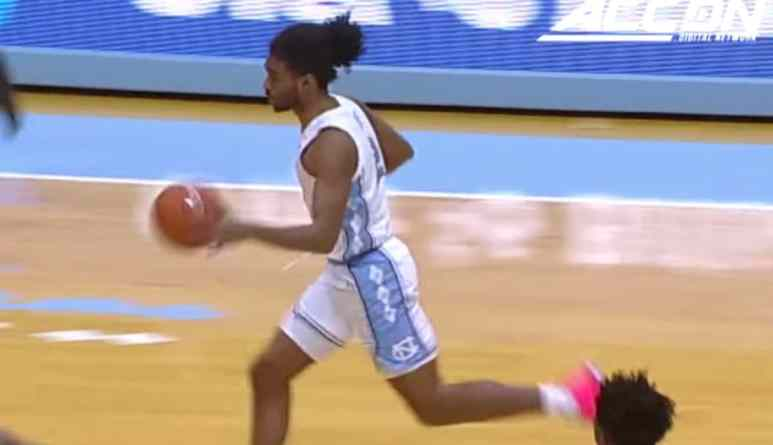 north carolina guard coby white on a fast break play