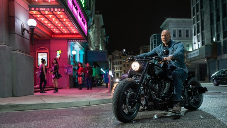Dwayne Johnson as Luke Hobbs on a motorcycle in Hobbs and Shaw