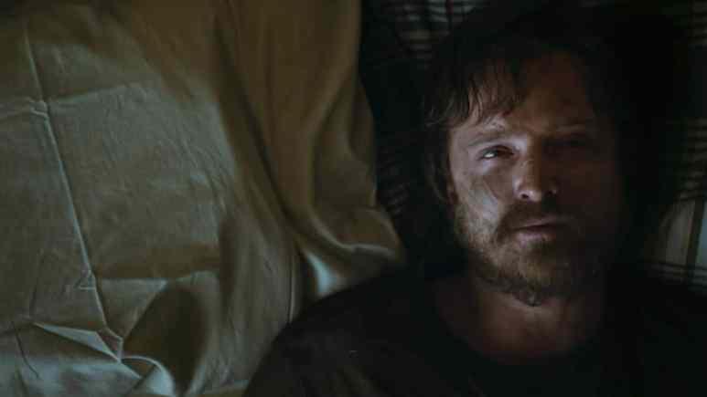 Aaron Paul as Jesse Pinkman laying on Skinny Pete's bed in El Camino