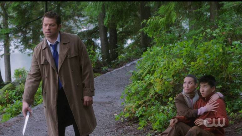 Misha Collins as Castiel protects a family from a monster. Pic credit: The CW