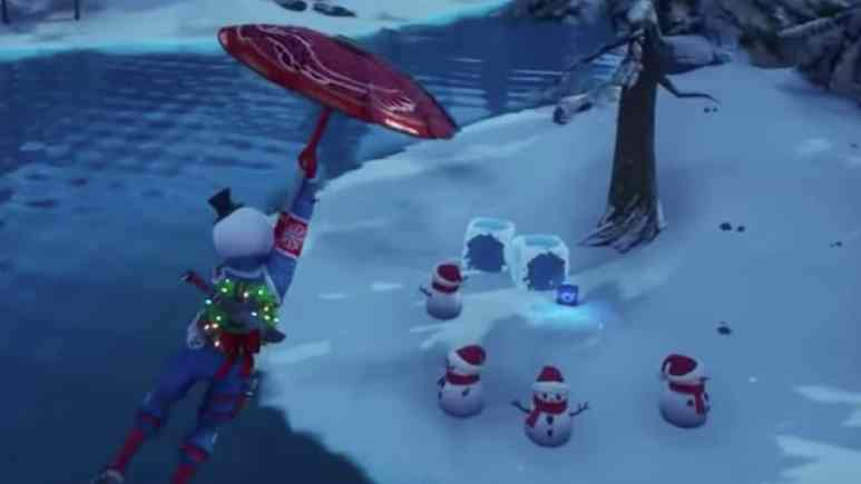 fortnite winterfest challenge with frozen loot cubes at misty meadows