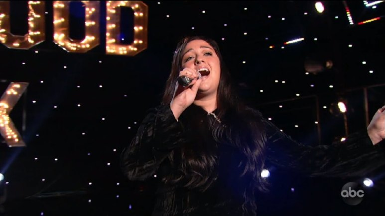 Ren Patrick sings on the Idol stage during duet round