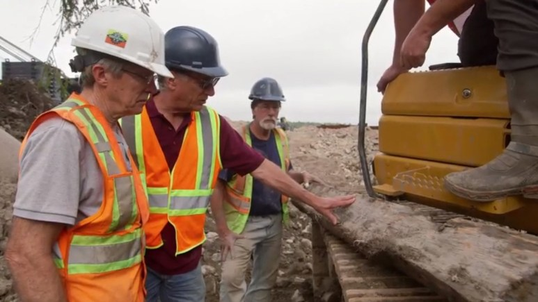 The Oak Island team examine an old beam