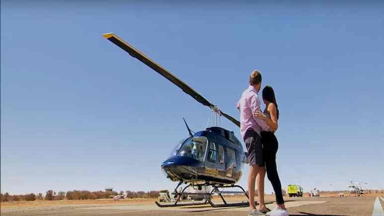 In Part 1 of The Bachelor's season 24 finale,Peter Weber and Hannah Anne embrace in front of a helicopter in Australia.