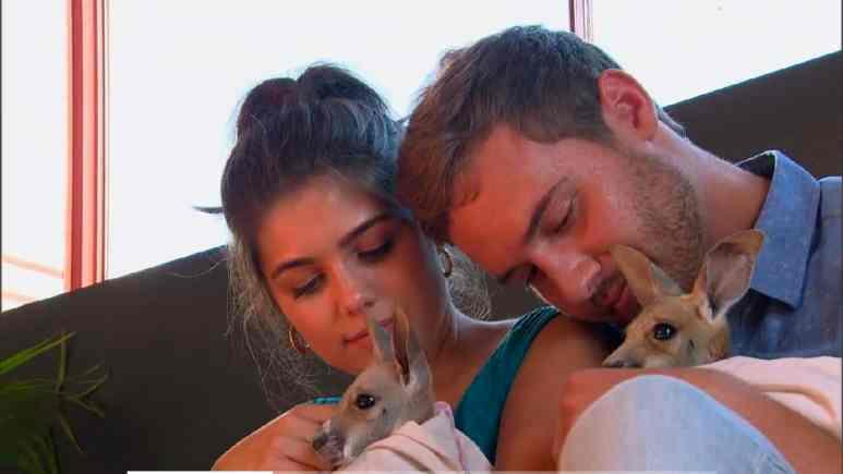 Peter and Hannah Ann hold baby kangaroos
