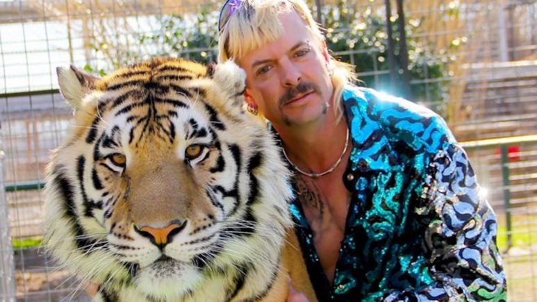 Joe Exotic poses with one of his tigers