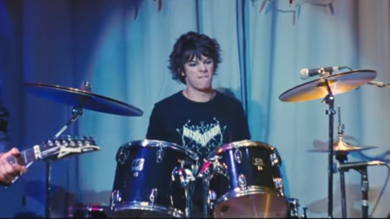 Roderick Heffley on stage playing the drums