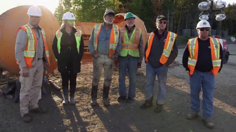 The Oak Island team watch the drilling process