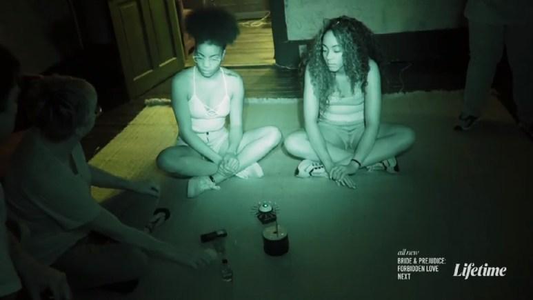 meka and taylor sitting on floor
