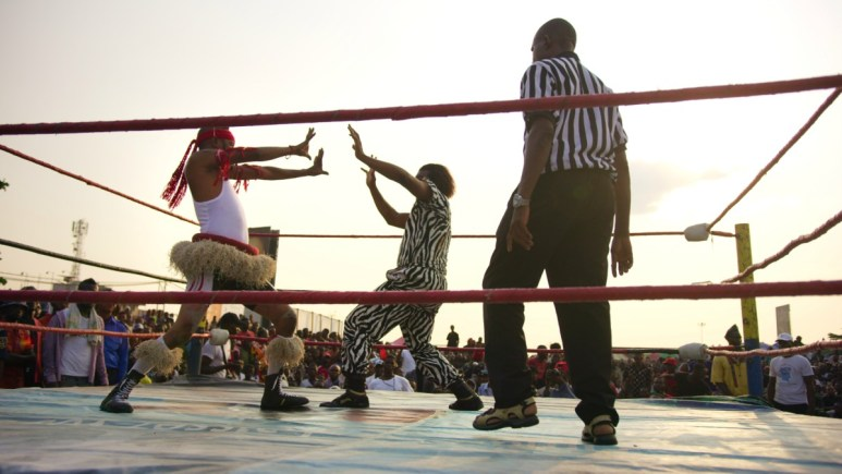 Two wrestlers, competing in Catch Fétiche, also known as Voodoo Wrestling in Home Game.