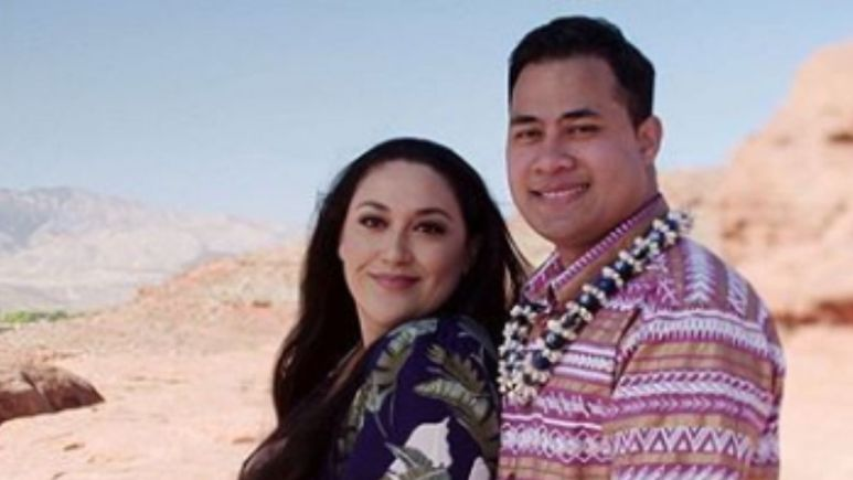 Kalani and Asuelu posing together in front of a view