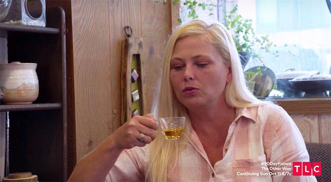 Elicia drinking tea