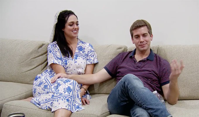 MAFS Season 11 couple Henry and Christina showing slight affection sitting on couch