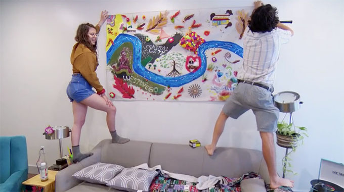 MAFS Season 11 couple Bennett and Amelia hanging a hand-painted mural